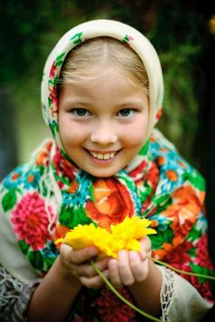 A smiling blonde girl with blue eyes is wearing the Russian traditional shawl. #cute #kids #Russian #folk