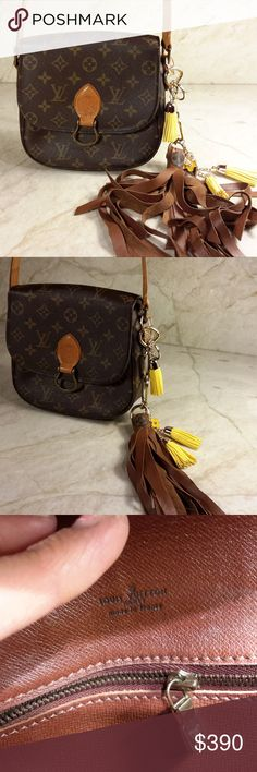 Louis Vuitton Monogram Saint Cloud w/charms From FRANCE Gorgeous everyday purse.  Very  nice Vintage condition. Pocket peeled , does not affect pocket use.   Styled with:  comes with 7 inch leather tassel with LV monogram  Purse comes with purse charms 3 leather flowers 1 enamel LV charm, 2 key rings  A Vintage bag will have normal signs of wear, edges have tiny cracks, normal use.  This purse will last for many more years. Patina leather straps  Not a new purse, but wonderful for the hip…