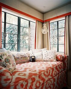 adore this little love seat in coral and white with the beautiful window treatment of valances.