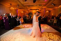 A rose motif design is projected onto the dance floor, creating a romantic vibe