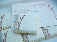 https://flic.kr/p/ahzC4j | Monogram Wedding Cookies | Monogrammed cookie favors I made for a best friend's wedding.  I loved being able to do this for them to help them celebrate their day.  I love you and wish you a lifetime of happiness Ian & Kim!  I had done similar monograms before and we added the blossoms to the design to coordinate with the wedding invitation and program.
