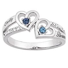 this'd be cool as an engagement ring. the birthstones and the names engraved.