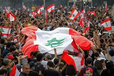 Lebanese demonstrators wave the national flag during a protest against dire economic conditions in downtown Beirut. (Photo by IBRAHIM AMRO / AFP) (Photo by IBRAHIM AM Arab World, Beirut Lebanon, Morals, Crowd, National Flag, Wave, Earth, English, Photos
