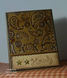 Faux Leather -  Run kraft cardstock through with the Paisely folder. Rubbed Close to Cocoa ink over the raised parts. Stamped over entire panel with Versamark ink pad and then clear embossed twice. Sponged the edges.