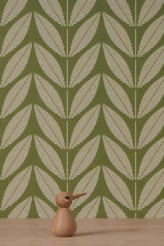 An all over geometric stem wallpaper design inspired from emerging seedlings.