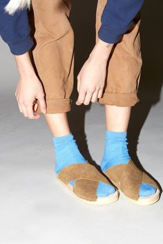 Socks with sandals and rolled chinos sound nerdy in theory, but this outfit inspiration proves the combo is anything but. The repetition of tans and blues are also really modern and lovely.