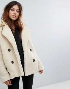 Stay cosy in a Free People Teddy Peacoat