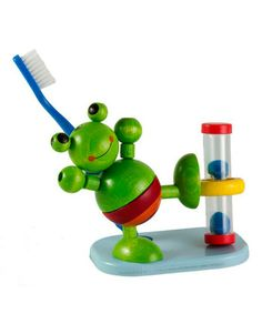 Tooth brush holder with hourglass to ensure toddler brushes teeth long enough