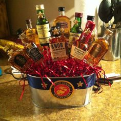 You need: 1 pot Ribbon of your choice mini liquor bottles Glue gun and glue sticks The stuffing to go in the pot Floral Styrofoam And any other small decorations, such as the starts I added to the bottles. Alcohol Gift Baskets, Alcohol Gifts, Liquor Bouquet, Candy Bouquet, Craft Gifts, Diy Gifts, Mini Liquor Bottles, Holiday Baskets, My Husband Birthday