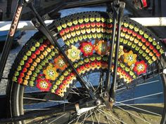 Crocheted skirt guard for your bike. It's like your own personal, moving yarn bomb.