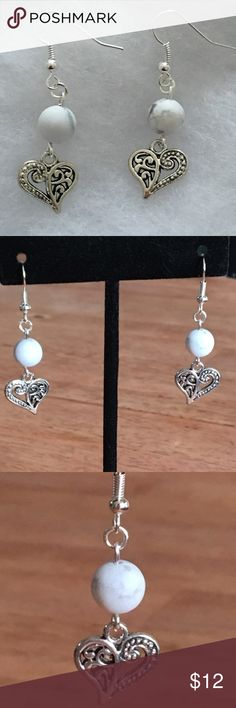 Natural White Howlite Silver Heart Earrings These beautiful earrings are made with natural matte white howlite. The heart charms are silver tone and the hooks are sterling silver.   All PeaceFrog Jewelry items are handmade by me! Take a look through my boutique for coordinating jewelry and more unique creations. PeaceFrog Jewelry Earrings