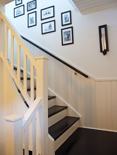 Stairway in black, grey and white with framed pictures. Paneling Makeover, Hut House, Stairway Decorating, Stair Railing, Basement Remodeling, Stairways, Mudroom, Beach House, New Homes