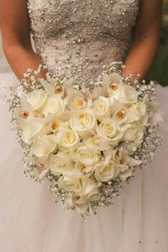 Heart Bridal Bouquet Comprised Of: White Roses, White Cymbidium Orchids & White Gypsophila