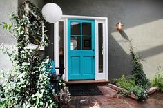 Light Gray Front Door | Turquoise trimmed in white gives a crisp look!
