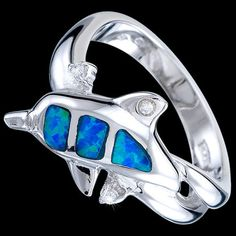 Adorable Silver Ring With Opal and Zircons http://blueshinejewellery.com/collections/silver-rings-toe-rings/products/silver-ring-zirconia-opal-dolphin Visit Our Website and Save 10%! Silver ring, Ag 925/1000 - sterling silver. With stone (Cubic zirconia,opal). Dolphin is playing in the waves decorated with the real opal of sea colour and with zirconia. Rhodium-plated. Width at the place of pattern approx. 11mm. #silverring #opalring #cubiczirconiajewelry #dolphin #jewelryonlinestore