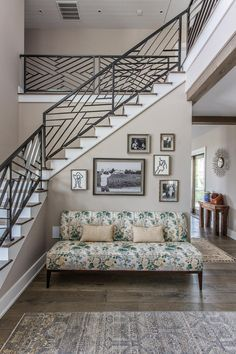 No space is wasted in this beautiful design by Cortney Bishop Design. The chic foyer features a small gallery wall and floral settee.