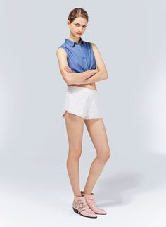 Fully lined, these mini shorts are designed with an elastic waistband, so they just pull on, and are finished with a scalloped lace trim on the hem that is unlined to show a hint of skin.