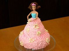Barbie Cake 101  Its Easier Than You Think! Barbie Cake using a Bundt pan! This one looks a bit messy imo. I'm glad I have the triple star tip ;) Adding ruffles in the front instead of all stars I think would look much better Bolo Barbie, Barbie Cake, Barbie Dolls, Barbie Doll Birthday Cake, Barbie Party, Birthday Cakes, Birthday Ideas, 8th Birthday, Birthday Parties