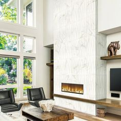 Bring depth and texture with this cozy MARAZZI Developed by Nature Calacatta Glazed Ceramic Wave Wall Tile. Tiled Fireplace Wall, Fireplace Tile Surround, Linear Fireplace, Tall Fireplace, Bedroom Fireplace, Home Fireplace, Fireplace Remodel, Living Room With Fireplace, Fireplace Surrounds