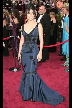 What: Prada Where: Academy Awards in 2005 Why: Hayek played up her best assets, her famous curves, in this navy and black embroidered dress.   - HarpersBAZAAR.com