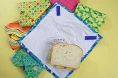 DIY plastic-lined sandwich wraps. Simple sewing project, machine washable, line dry. I'd use iron-on vinyl vs fused plastic grocery bags or ziploc bags for liner Reusable Sandwich Bags, Reusable Bags, Fabric Crafts, Sewing Crafts, Sewing Projects, Fused Plastic, Plastic Wrap, Homemade Sandwich, Recycling