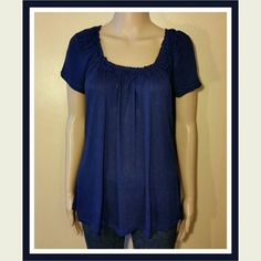Kenneth Cole Short Sleeve Blouse So soft and comfortable, the measure of quality, exceeds expectations in this navy Kenneth Cole Reaction short sleeve top. Gathered with flowers at the scoop neckline, it is a somewhat sheer fabric. 100% Rayon. SORRY NO TRADES. Kenneth Cole Tops Blouses