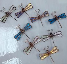 Stained Glass Dragonflies on Etsy, $5.00 - nice simple things to make. Soldering fairly critical, I would think. Also need copper sulfate.