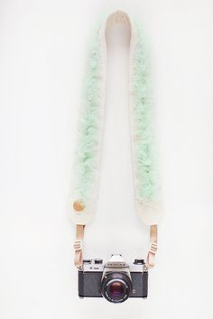 """THIS IS A CAMERA STRAP. WITH TULLE. IN MINT GREEN. YES I AM YELLING!!!!    """"This mint-colored, jeweled strap will transform you into a Prima Ballerina. Fluffy layers of tulle are bound together by a string of crystals. Together, these elements create the perfect balance of femininity and softness.""""    I AM UNDONE!!!!!!!!!!!!!!"""