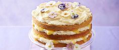 A showstopping, lemony sponge cake with a delicious curd icing and beautiful edible crystallised violets and primroses from eatmyflowers.co.uk.