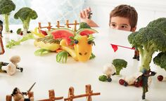 Food design - use broccoli as trees (with gingerbread houses) and pretzel sticks as fencing