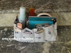 Tutorial for making a 24-pocket bag organizer. Makes changing purses easier.