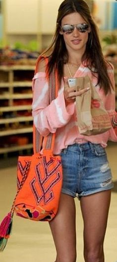Alessandra Ambrosio wearing her mochila Wayuu bag