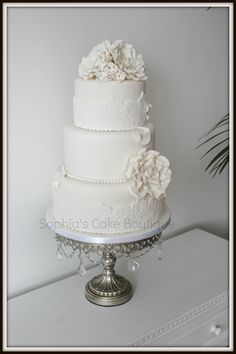 Round Wedding Cakes - White on White 3 tier cake, lace roses and pearls, more romantic vintage style.