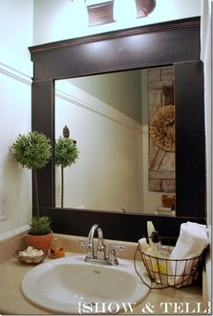 Great For A Guest Bathroom   Basket Keeping Everything In Place. Framed Up  Builder Grade Mirror ...