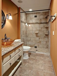 Sherwin-Williams' Brandywine (SW 7710) pairs well with natural stone tiles.