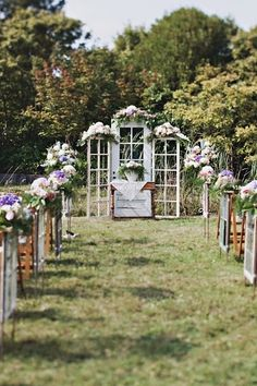 Vintage, old wooden windows decorate an outdoor wedding.
