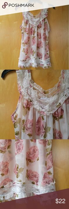 """Charlotte Russe Sheer Floral Lace Trim Tank Charlotte Russe floral sleeveless blouse, size medium, in perfect condition! Tank is sheer, features a gorgeous red, pink, and green floral print, and lace along shoulder straps, v-neck neckline, and bottom hem. Bottom hem is also a rough edge. So delicate and darling. Flowy and perfect for summer! Measurements are 20"""" pit to pit and 25.5"""" shoulder to bottom hem. Please ask any questions. No trades. Make a reasonable offer. Thanks! Charlotte Russe…"""