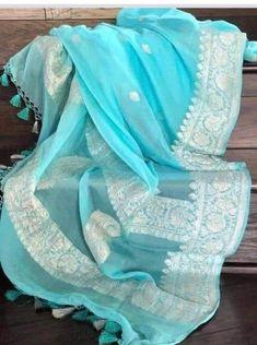 No photo description available. Blue Silk Saree, Cotton Saree, Indigo Saree, White Saree, Rajasthani Lehenga, Indian Lehenga, Indian Gowns, Chiffon Saree Party Wear, Banarsi Saree