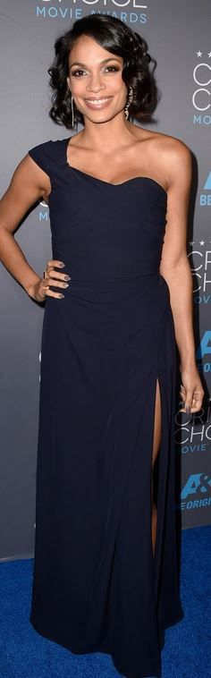 Who made  Rosario Dawson's blue one shoulder gown that she wore in Los Angeles on January 15, 2015?