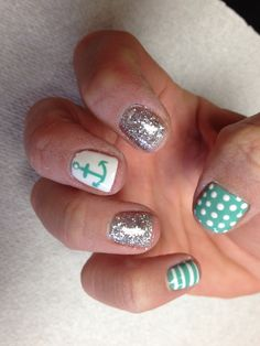 Teal and white poke a dots and stripes with silver glitter accent nail and anchor and starfish accent nails  Oasis Salon and Spa Mill Hall Pa (570)726-6565