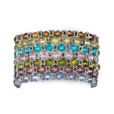 Pile on the latest look with this set of seven multicolor crystal bracelets designed to make a brilliant fashion statement.