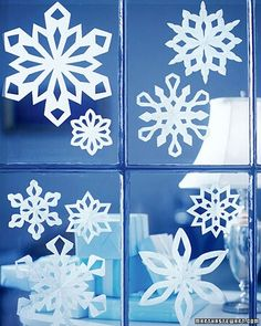 Snowflakes on windows. Although its summer here during Christmas, it really gives it that holiday feel :)