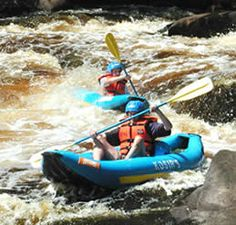 Whitewater rafting in a inflatable kayak (affectionately called a fun-yak)  :-)