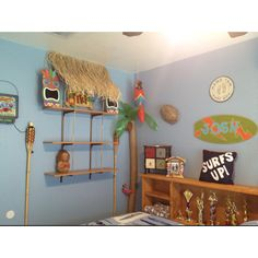 Surfboard room with tiki hut shelves for kid's room
