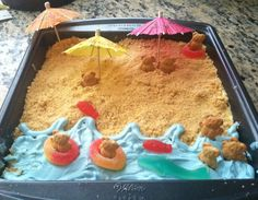 """Kids """"Beach"""" Cake. When I had this cake, I used Polly Pocket dolls instead of the bears. I also used fruit stripe gum, paper parasols, etc."""