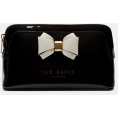 Ted Baker Curved bow small wash bag (€29) ❤ liked on Polyvore featuring beauty products, beauty accessories, bags & cases, bags, borse, black, makeup purse, makeup bag case, travel kit and make up purse