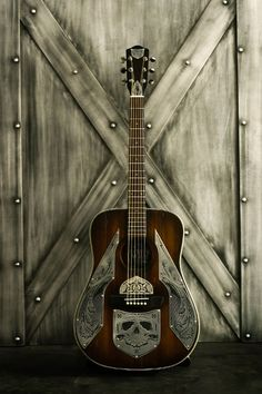 Don't know what brand Resonator this is, but it has to be one of the most beautiful guitar portraits I've ever seen. Think I'm gonna frame this one for the music room. ~Rooster