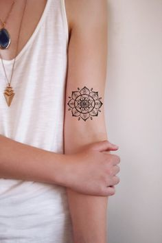 An intricate mandala temporary tattoo.