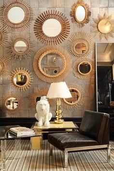A wall of golden starburst mirrors (La Maison Gray - Interiors) #interior #retro #midcentury #starburst #mirror #design #gold #brass