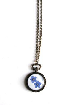 Hey, I found this really awesome Etsy listing at https://www.etsy.com/listing/175433804/forget-me-not-resin-pendant-necklace